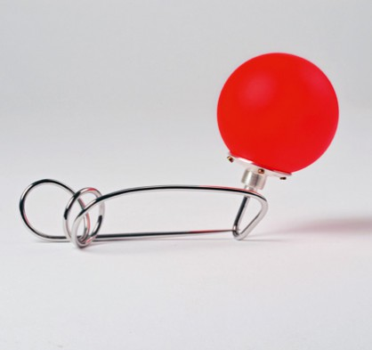 Sigurd Bronger, Carrying device for a ping pong ball, stainless steel, silver, painted ping pong ball
